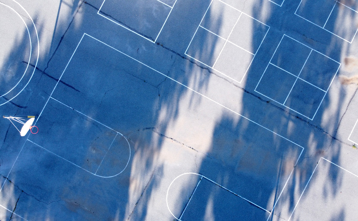 "Photo © Eric Platt 2000, ""Symphony in PlayGround Pavement, Tree Shadows, and One Hoop"""