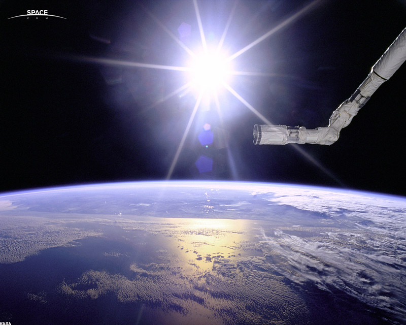 The first source photo. Obviously I didn't take this. That's a robotic arm from the Space Shuttle. I liked the look of the limb of the Earth.